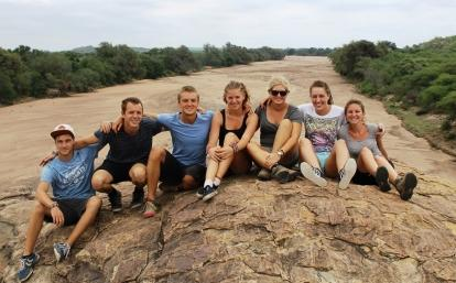 Projects Abroad wildlife conservation volunteering group in Botswana sitting on top of a hill